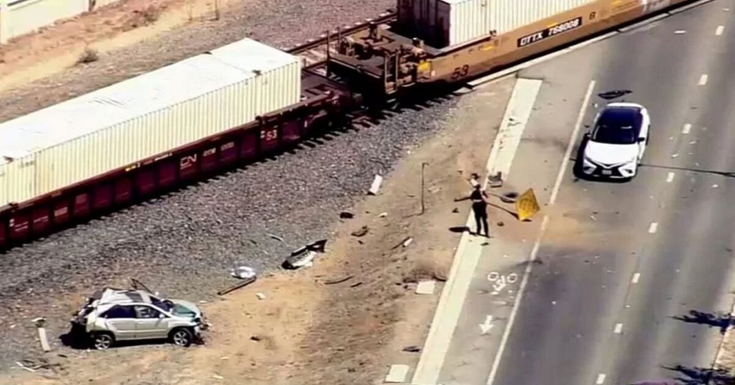 A horrific collision between freight train & car leaves 12-year-old dead